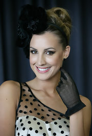 Laura Dundovic attended Golden Slipper Day wearing an elaborate black headband with her retro outfit.