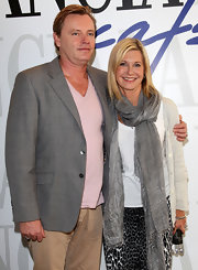 Olivia Newton-John's fondness for scarves showed as she wore another one while out at Lancia Cafe.