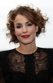 A swipe of red lipstick gave Noomi Rapace's beauty look a rich dose of color.