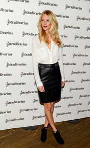 Poppy Delevingne styled her shirt with an edgy-chic leather pencil skirt.