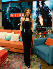 Kate Beckinsale cut a sleek silhouette in a strapless black jumpsuit by Elie Saab on the set of 'Despierta America.'