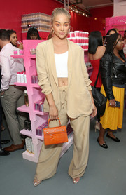Jasmine Sanders rocked an oversized beige pantsuit by Baja East at the launch of Beautyblender Bounce Liquid Whip Foundation.