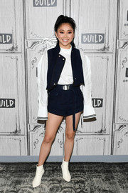 For her footwear, Lana Condor chose a pair of white booties.