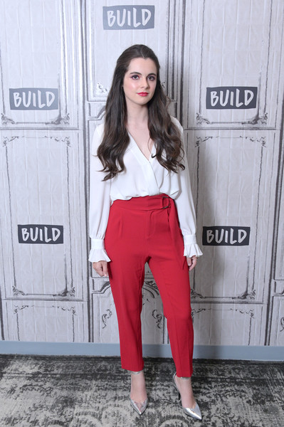 Vanessa Marano completed her outfit with a pair of red slacks.