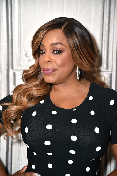 Niecy Nash flaunted glamorously styled waves while visiting Build.