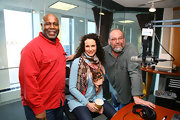 Andie MacDowell wore a colorful mixed print scarf for her visit to Sirius radio.