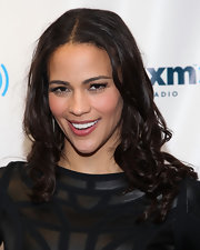 Paula Patton wore a pair of long feathery lashes at while visiting SiriusXM Studio.