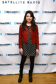 Miranda Cosgrove kept her sweet polkadot dress casual with the addition of a rust jacket.