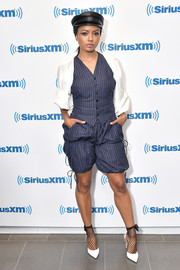 Kat Graham looked funky in a pinstriped short suit with contrast sleeves while visiting SiriusXM.
