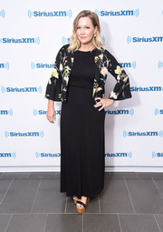 Jennie Garth layered a floral jacket over her dress for a chicer finish.