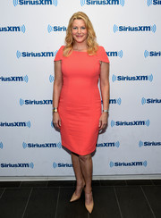 Anna Gunn sheathed her figure in a fitted coral dress for her visit to SiriusXM.