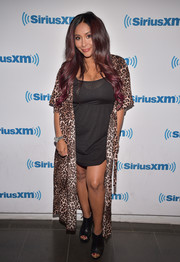 Nicole Polizzi was boudoir-chic in a leopard-print robe while visiting SiriusXM.