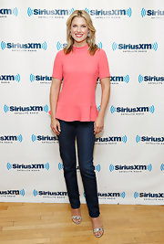 Ali wore this figure-flattering coral pink peplum top with her skinny-fit jeans while at the SiriusXM studios.