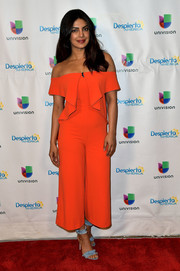 Priyanka Chopra totally brightened up the show with this orange off-the-shoulder jumpsuit by Lavish Alice when she appeared on 'Despierta America.'
