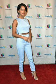 Isabela Moner teamed her top with matching high-waisted trousers.