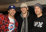 Michael Phelps matched a black and tan wool scarf to the rest a khaki cap and black sweater.