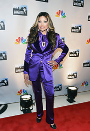 La Toya Jackson made quite the statement in a shiny, bright purple suit.