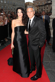 Amal Alamuddin was the picture of classic elegance in a black Dolce & Gabbana strapless gown during the Celebrity Fight Night.