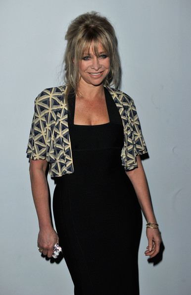 A cropped geometric print jacket provided a visual contrast to Jo's fitted black dress at the PPQ Autumn-Winter 2011 fashion show in London.