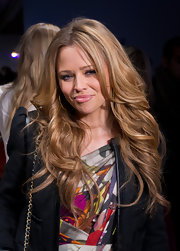Kimberley Walsh was gorgeously coiffed in a flowing feathered flip during London Fashion Week.