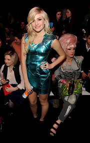 Pixie attended London Fashion Week in a aqua blue metallic dress.