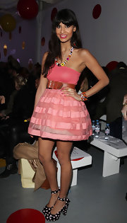Snapped front row at  London Fashion Week 2011, Jameela looked adorably stylish in this coral prom-style strapless frock.