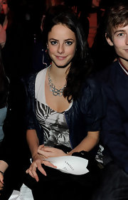 Kaya Scodelario glammed up her casual ensemble at the PPQ fashion show with a silver link necklace.