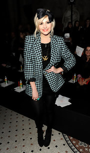 Pixie paired her plaid blazer with a black hair bow for added flair.