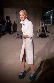 Daphne donned a slim fitting white knee-length coat for the Cristopher Kane London show.