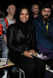 Ms. Jackson is seen her sitting front row at yet another fashion show. Normally Janet wears her hair straight, but recently she has been seen rockin' a curly look. Cute!