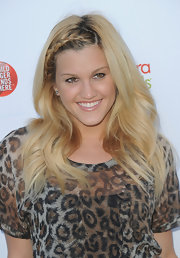 Ashley displayed her funky style at this Hollywood event donning a long straight look with a braided side part. Too cute!