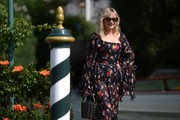 Kirsten Dunst headed out during the Venice Film Festival carrying a quirky zigzag-studded bucket bag by Sara Battaglia for Salvatore Ferragamo.