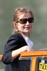 Isabelle Huppert topped off her smart attire at the Venice Film Festival with rectangular sunnies.