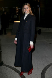 Olivia Palermo chose a pair of red ankle boots by Christian Louboutin to team with her coat.