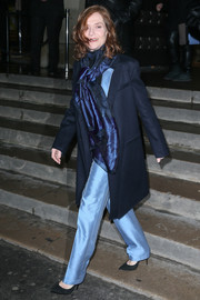 Isabelle Huppert was spotted out and about during Paris Fashion Week wearing a classic navy coat.