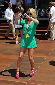 Geri Halliwell added color to her playful green romper with fuchsia suede platform sandals.