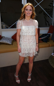 Geri Halliwell teamed her dress with a pair of white evening sandals featuring chain-embellished ankle straps.
