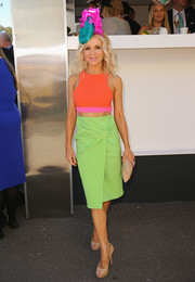 Danielle Spencer went for a color-blocked finish, pairing her top with a lime-green pencil skirt with gathered detailing.