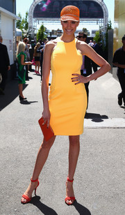 Rachel Finch brought a bright pop of color to Melbourne Cup Day with her yellow Ellery sheath and orange accessories.