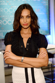 Madalina Diana Ghenea looked very ladylike in a fitted black tie-neck blouse during her visit to the Variety Studio.