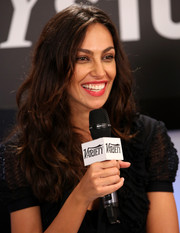 Madalina Diana Ghenea wore her hair in wild waves with a center part during her visit to the Variety Studio.