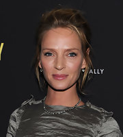Uma Thurman added a sparkling touch to her look for the New York screening of 'Ceremony' with old-mine diamond drop earrings. They     were a beautiful and classic complement to her chic attire.