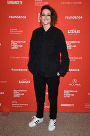 Kristen Stewart teamed her jacket with tapered black slacks by The Kooples.
