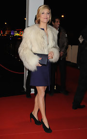 Marina loves her fur coats!  Here she dons a thick and fluffy cropped style.