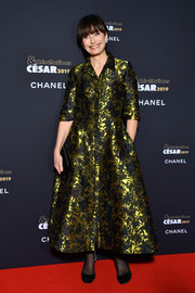 Kristin Scott Thomas gleamed in a gold and black jacquard shirtdress by Erdem at the Cesar Revelations 2019.