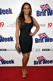 Mel B completed her figure-hugging LBD with a pair of satin mustard-hued peep-toe pumps with black trim.