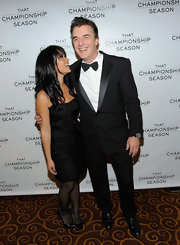 Wearing a chic black strapless dress with ruched panel detailing, Tara Wilson gazed lovingly at husband Chris Noth at a party in NYC.