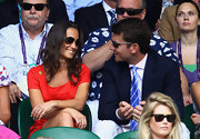 Alex Loudon watched a match at Wimbledon with his ex-girlfriend Pippa Middleton.  He sported a blue striped tie.