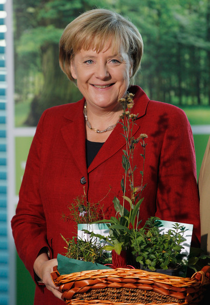German Chancellor Angela Merkel wore her hair in a short bob with front bangs.