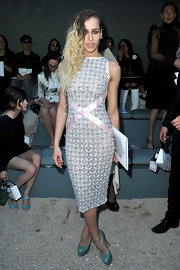 Striking a sultry pose at the Chanel Cruise collection, Alice Dellal looked breathtaking in her delicately beaded dress.